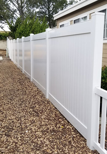 Vinyl Property Line Fence in Carson